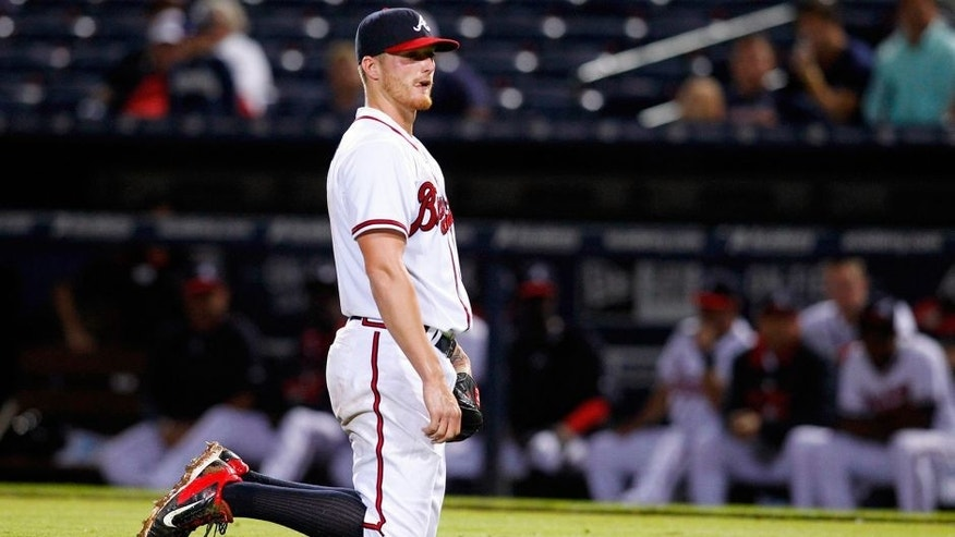 Sep 10, 2015; Atlanta, GA, USA; Atlanta Braves starting pitcher Shelby Miller (17) reacts after falling off of the mound against the New York Mets in the sixth inning at Turner Field. Mandatory Credit: Brett Davis-USA TODAY Sports