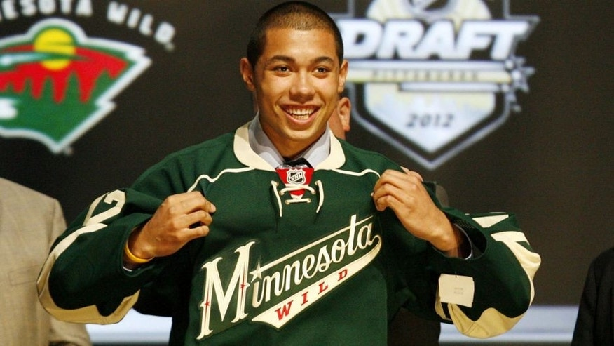 <p>June 22, 2012; Pittsburgh, PA, USA; Matthew Dumba puts on a jersey after being selected as the number seven overall draft pick to the Minnesota Wild in the 2012 NHL Draft at CONSOL Energy Center. Mandatory Credit: Charles LeClaire-USA TODAY Sports</p>