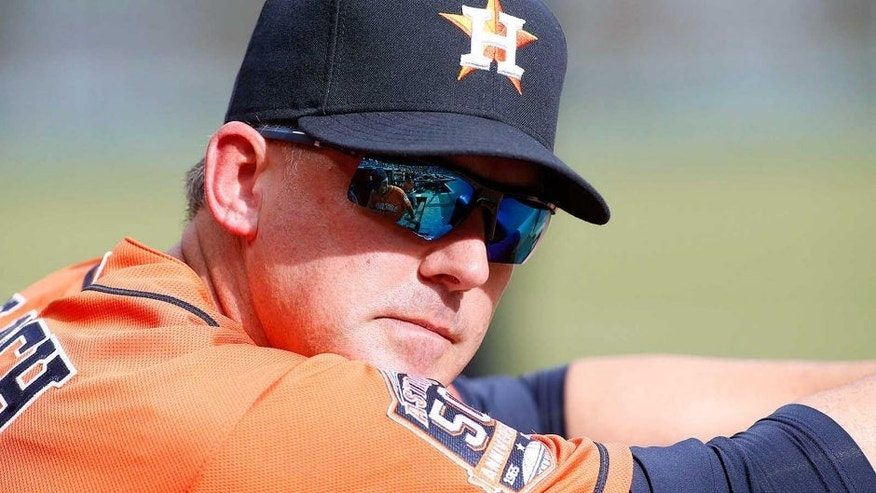 <p>Apr 10, 2015; Arlington, TX, USA; Houston Astros manager A.J. Hinch (14) in the dugout during the game against the Texas Rangers at Globe Life Park in Arlington. Houston beat Texas 5-1. Mandatory Credit: Tim Heitman-USA TODAY Sports</p>