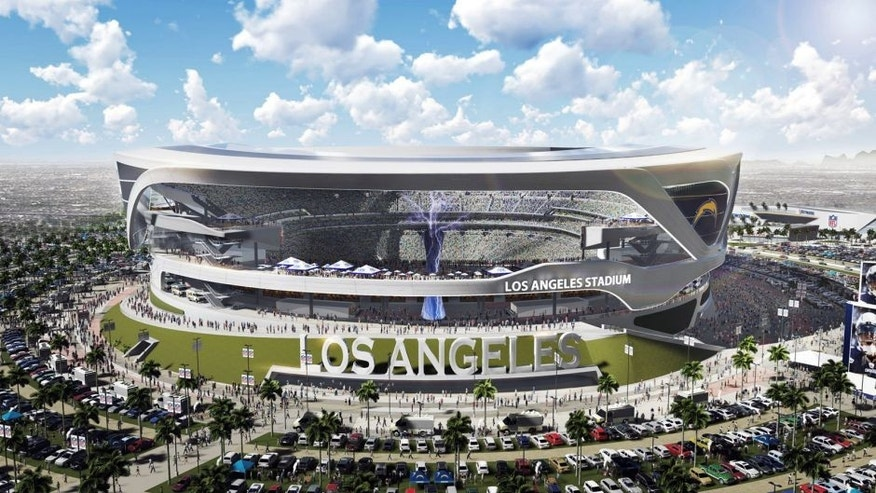 This artist's rendering provided by Carson2gether shows the exterior of a newly revised plan for a proposed stadium that would house both the Chargers and the Raiders NFL football teams, here in Chargers' home game configuration, in Carson, Calif. New designs for the proposed NFL stadium in the Los Angeles area include simulated lightning bolts for the San Diego Chargers and an eternal flame honoring late Oakland Raiders owner Al Davis. The thoroughly revamped stadium renderings for the $1.7 billion joint stadium planned by the two teams were released on Thursday, April 23, 2015. (Manica Architecture/Carson2gether via AP)