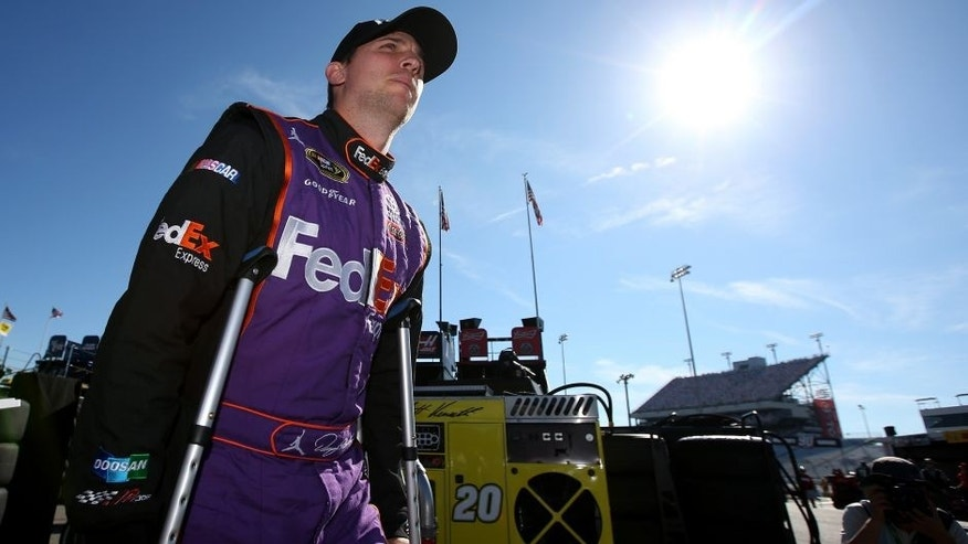 RICHMOND, VA - SEPTEMBER 11: Denny Hamlin, driver of the #11 FedEx Express Toyota, walks through the garage area during practice for the NASCAR Sprint Cup Series Federated Auto Parts 400 at Richmond International Raceway on September 11, 2015 in Richmond, Virginia. (Photo by Chris Graythen/Getty Images)