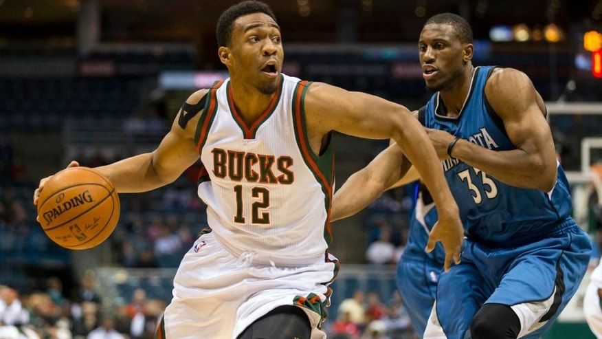 <p>Oct 22, 2014; Milwaukee, WI, USA; Milwaukee Bucks forward Jabari Parker (12) drives for the basket around Minnesota Timberwolves forward Thaddeus Young (33) during the first quarter at BMO Harris Bradley Center. Mandatory Credit: Jeff Hanisch-USA TODAY Sports</p>