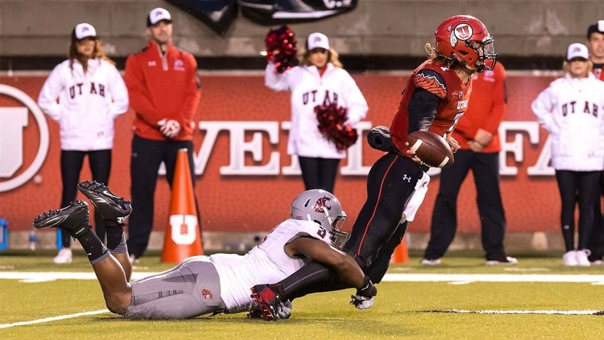 Sep 27, 2014; Salt Lake City, UT, USA; Utah Utes quarterback Travis Wilson (7) tries to get rid of the ball before being tackled by Washington State Cougars linebacker Ivan McLennan (3) during the first half at Rice-Eccles Stadium. Mandatory Credit: Chris Nicoll-USA TODAY Sports