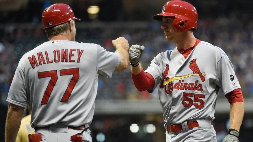 Aug 8, 2015; Milwaukee, WI, USA; St. Louis Cardinals left fielder Stephen Piscotty (55) is greeted by first base coach Chris Maloney after driving in a run with a base hit in the seventh inning against the Milwaukee Brewers at Miller Park. Mandatory Credit: Benny Sieu-USA TODAY Sports