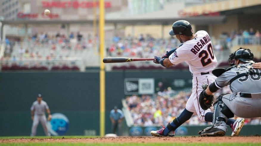 <p>Sep 3, 2015; Minneapolis, MN, USA; Minnesota Twins left fielder Eddie Rosario (20) hits a grand slam home run in the third inning against the Chicago White Sox at Target Field. Mandatory Credit: Brad Rempel-USA TODAY Sports</p>
