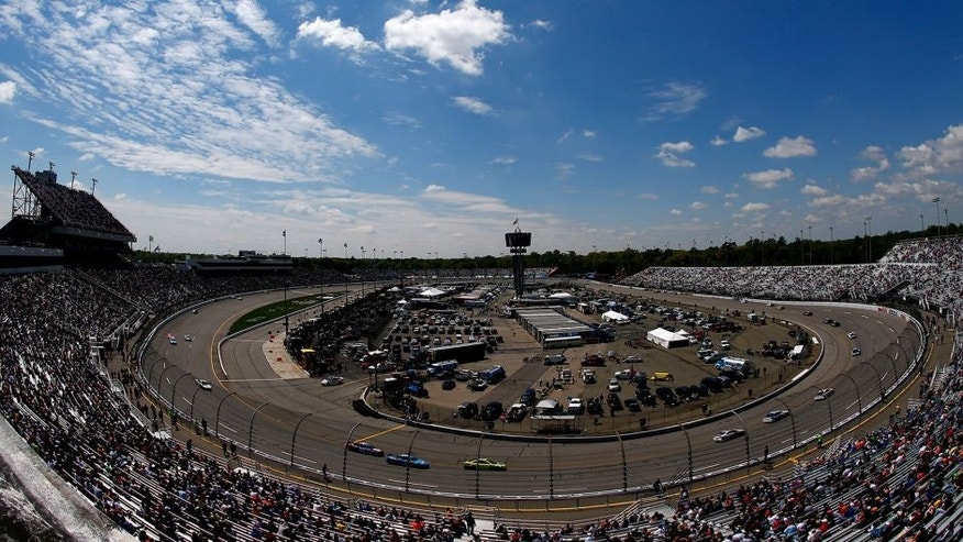 RICHMOND, VA - APRIL 26: Cars race during the NASCAR Sprint Cup Series Toyota Owners 400 at Richmond International Raceway on April 26, 2015 in Richmond, Virginia. (Photo by Kevin C. Cox/Getty Images)