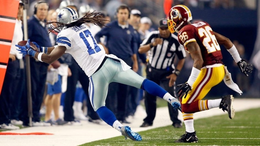 Oct 27, 2014; Arlington, TX, USA; Dallas Cowboys wide receiver Dwayne Harris (17) cannot make the catch against Washington Redskins cornerback Bashaud Breeland (26) in the second quarter at AT&T Stadium. Mandatory Credit: Tim Heitman-USA TODAY Sports