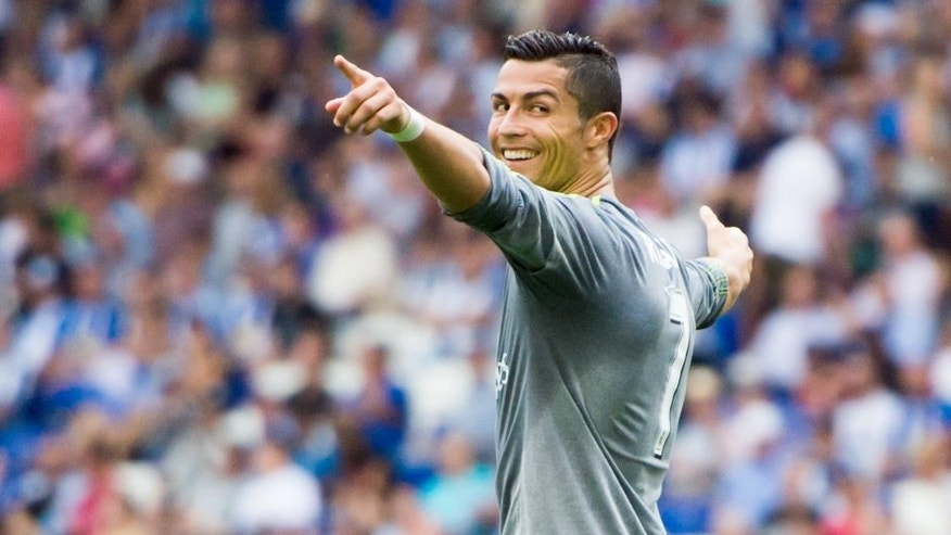 BARCELONA, SPAIN - SEPTEMBER 12: Cristiano Ronaldo of Real Madrid CF celebrates after scoring his team's sixth goal during the La Liga match between RCD Espanyol and Real Madrid CF at Cornella-El Prat Stadium on September 12, 2015 in Barcelona, Spain. (Photo by Alex Caparros/Getty Images)