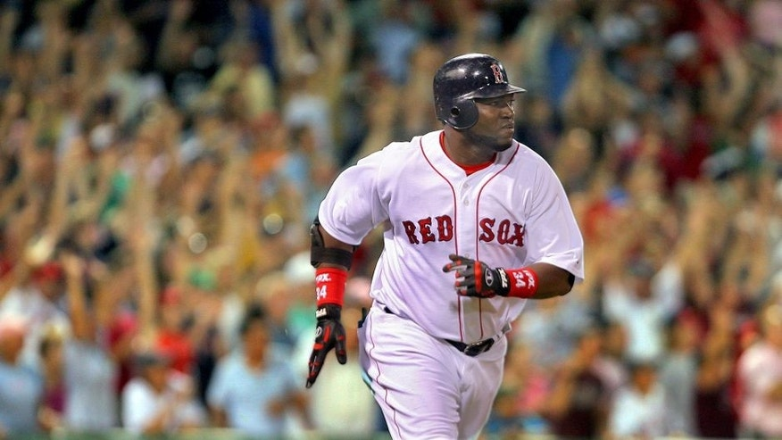 BOSTON - JULY 31: Red Sox designated hitter David Ortiz hit yet another game winning walk off home run, this one a three run blast that sent the crowd into a tizzy, and gave Boston a 9-8 victory. (Photo by Jim Davis/The Boston Globe via Getty Images)