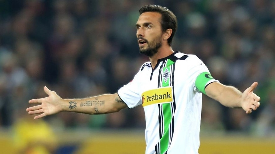 MOENCHENGLADBACH, GERMANY - SEPTEMBER 11: Martin Stranzl of Moenchengladbach lifts his arms during the Bundesliga match between Borussia Moenchengladbach and Hamburger SV at Borussia-Park on September 11, 2015 in Moenchengladbach, Germany. (Photo by Juergen Schwarz/Bongarts/Getty Images)