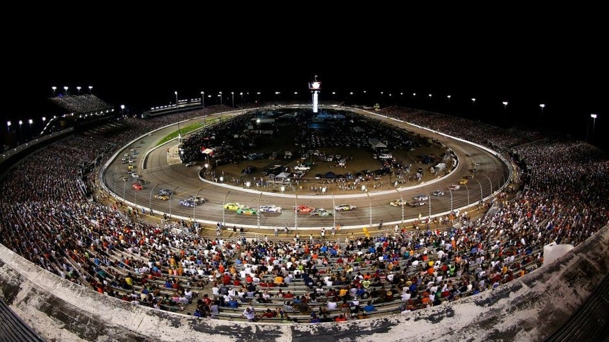 RICHMOND, VA - SEPTEMBER 06: A general view of cars racing the NASCAR Sprint Cup Series Federated Auto Parts 400 at Richmond International Raceway on September 6, 2014 in Richmond, Virginia. (Photo by Jared Wickerham/Getty Images)