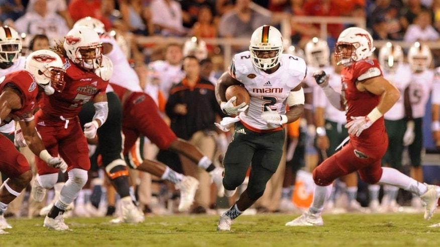 Sep 11,2015;Boca Raton, FL, USA; Miami Hurricanes running back Joseph Yearby (2) finds a hole as he runs the ball in the second quarter against the Florida Atlantic Owls at FAU Stadium. Credit:Robert Duyos-USA TODAY Sports