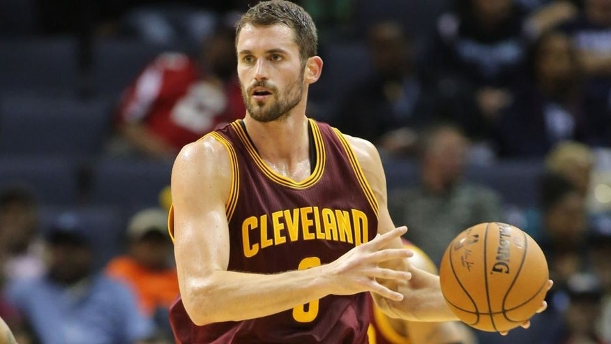 <p>Oct 22, 2014; Memphis, TN, USA; Cleveland Cavaliers forward Kevin Love (8) looks to pass in the game against the Memphis Grizzlies at FedExForum. Memphis defeated Cleveland 96-92. Mandatory Credit: Nelson Chenault-USA TODAY Sports</p>