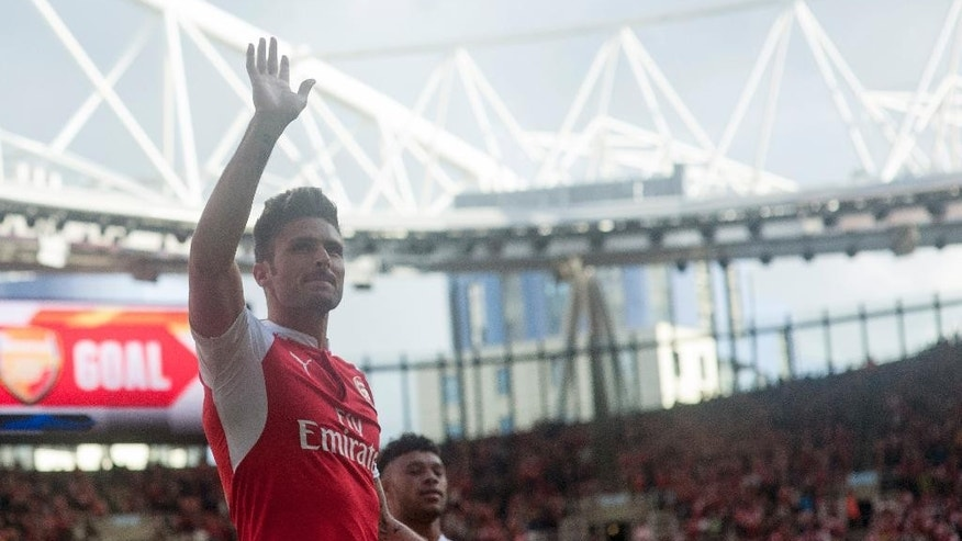 Arsenal's Olivier Giroud celebrates after scoring against Stoke City, during their English Premier League soccer match between Arsenal and Stoke City, at Emirates Stadium, in London, Saturday, Sept. 12, 2015. (AP Photo/Bogdan Maran)