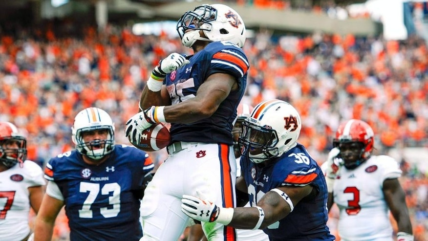 Sep 12, 2015; Auburn, AL, USA; Auburn Tigers running back Peyton Barber (25) celebrates his game-winning touchdown during overtime against the Jacksonville State Gamecocks at Jordan Hare Stadium. Auburn won 27-20. Mandatory Credit: Shanna Lockwood-USA TODAY Sports