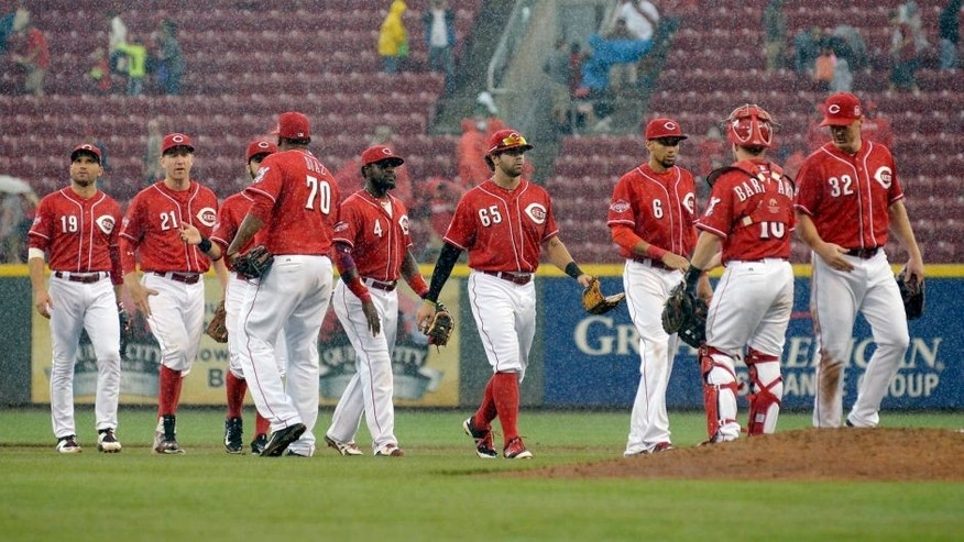 CINCINNATI, OH - SEPTEMBER 12: The Cincinnati Reds celebrate after beating the St. Louis Cardinals 5-1 at Great American Ball Park on September 12, 2015 in Cincinnati, Ohio. (Photo by Dylan Buell/Getty Images)