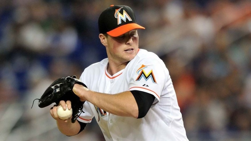 May 3, 2014; Miami, FL, USA; Miami Marlins relief pitcher Carter Capps (22) throws in the eighth inning against the Los Angeles Dodgers at Marlins Ballpark. Mandatory Credit: Steve Mitchell-USA TODAY Sports