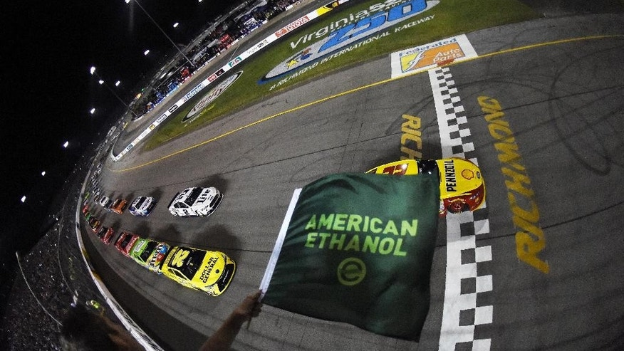 In a photo provided by NASCAR, Joey Logano (22) leads the field at the green flag to start the NASCAR Sprint Cup Series auto race at Richmond International Raceway on Saturday, Sept. 12, 2015, in Richmond, Va. (Rainier Ehrhardt/NASCAR via AP)