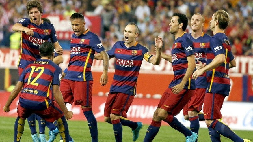 Barcelona's Neymar (3rd L) celebrates with team mates after scoring a goal against Atletico Madrid during their Spanish first division soccer match at Vicente Calderon stadium in Madrid, September 12, 2015. REUTERS/Javier Barbancho Picture Supplied by Action Images