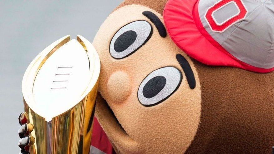 Jan 24, 2015; Columbus, OH, USA; Ohio State Buckeyes mascot Brutus Buckeye kisses the National Championship trophy during the National Championship celebration at Ohio Stadium. Mandatory Credit: Greg Bartram-USA TODAY Sports