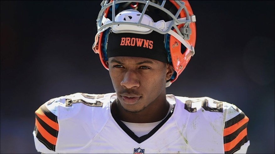 <p>Sep 14, 2014; Cleveland, OH, USA; Cleveland Browns cornerback Justin Gilbert (21) on the sidelines after being injured during the third quarter against the New Orleans Saints at FirstEnergy Stadium. Mandatory Credit: Andrew Weber-USA TODAY Sports</p>
