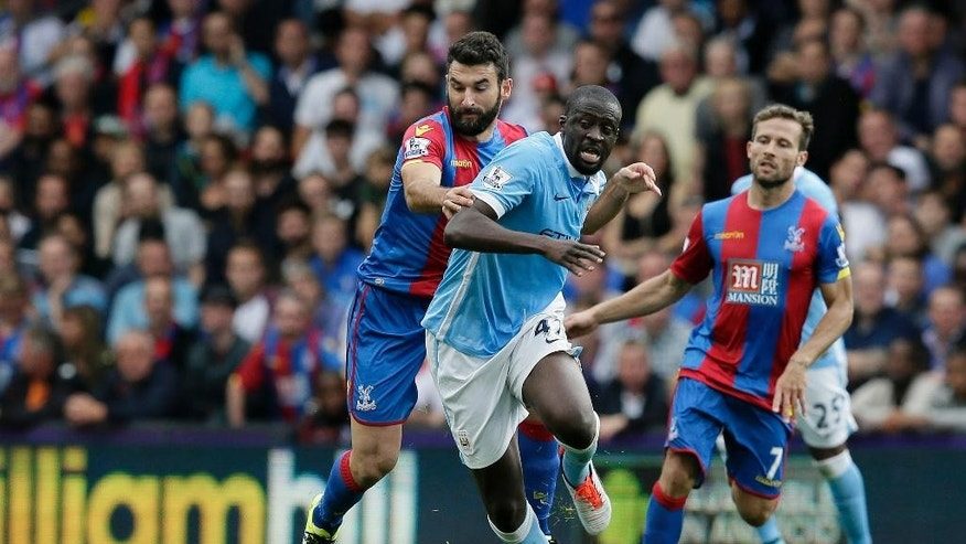 Manchester City's Yaya Toure, right, competes for the ball with Crystal Palace's Mile Jedinak during the English Premier League soccer match between Crystal Palace and Manchester City at Selhurst Park, London, Saturday, Sept. 12, 2015. (AP Photo/Tim Ireland)