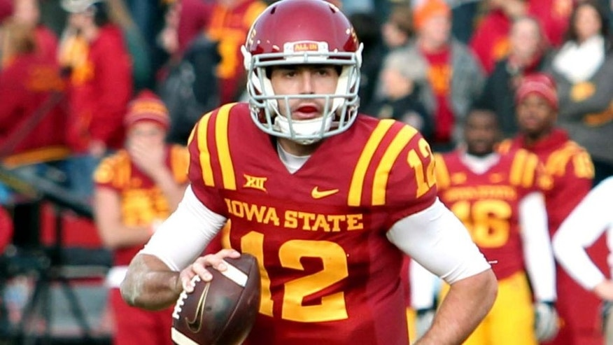 Nov 29, 2014; Ames, IA, USA; Iowa State Cyclones quarterback Sam B. Richardson (12) rolls out to pass against the West Virginia Mountaineers at Jack Trice Stadium. The Mountaineers beat the Cyclones 37 - 24. Mandatory Credit: Reese Strickland-USA TODAY Sports
