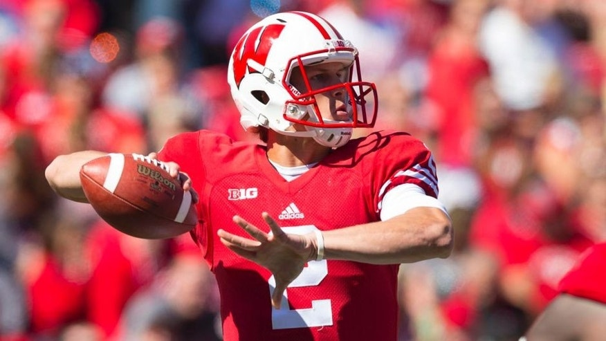 Wisconsin Badgers quarterback Joel Stave throws a pass during the first quarter against the Miami (Ohio) RedHawks at Camp Randall Stadium in Madison, Wis., on Saturday, Sept. 12, 2015.