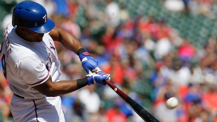 Texas Rangers Adrian Beltre hits a two run homer during the fourth inning of a baseball game against the Oakland Athletics in Arlington, Texas, Sunday, Sept. 13, 2015. Rangers Shin-Soo Choo also scored on the play. (AP Photo/LM Otero)
