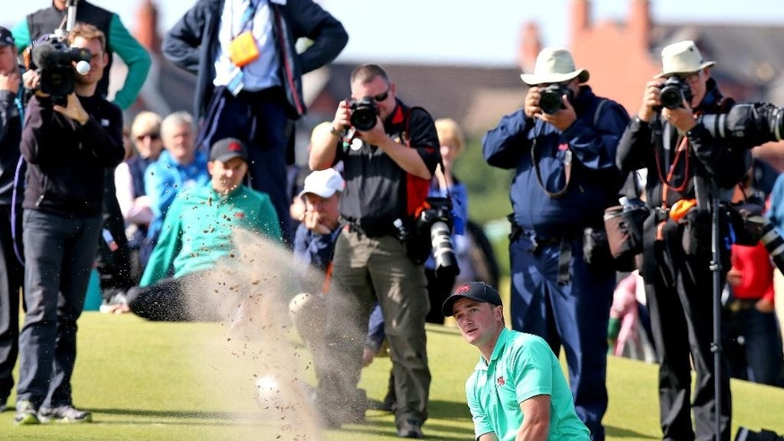 Great Britain and Ireland's Paul Dunne chips out of the bunker on the 16th hole during day two of the Walker Cup at Royal Lytham & St Annes Golf Club, Lytham St Annes, England, Sunday Sept. 13, 2015. (Peter Byrne/PA via AP) UNITED KINGDOM OUT  NO SALES  NO ARCHIVE