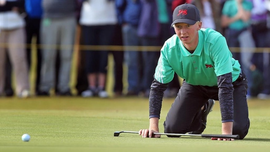 Great Britain and Ireland's Jimmy Mullen eyes up a putt on 16th green during day two of the Walker Cup at Royal Lytham & St Annes Golf Club, Lytham St Annes, England, Sunday Sept. 13, 2015. (Peter Byrne/PA via AP) UNITED KINGDOM OUT  NO SALES  NO ARCHIVE
