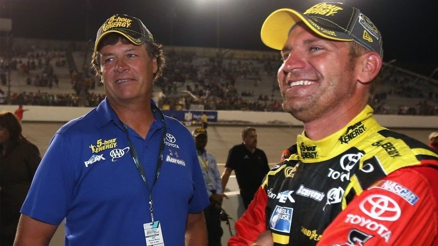 RICHMOND, VA - SEPTEMBER 12: Clint Bowyer, driver of the #15 5-hour Energy Toyota, talks to team owner, Michael Waltrip after the NASCAR Sprint Cup Series Federated Auto Parts 400 at Richmond International Raceway on September 12, 2015 in Richmond, Virginia. (Photo by Chris Graythen/Getty Images)