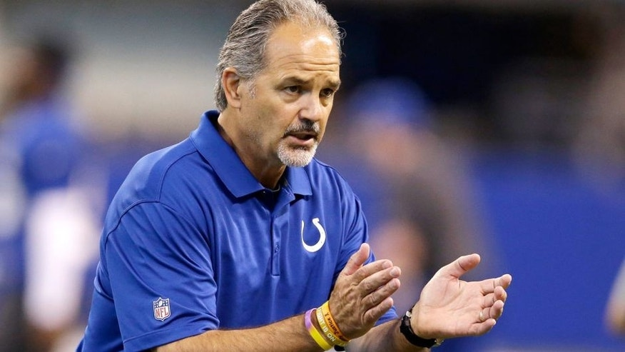 Indianapolis Colts coach Chuck Pagano encourages his team during an NFL football organized team activity Wednesday, June 10, 2015, in Indianapolis. (AP Photo/Darron Cummings)