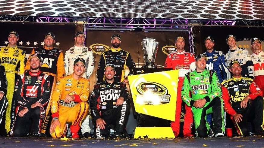 (Back row L-R) Matt Kenseth, driver of the #20 Dollar General Toyota, Ryan Newman, driver of the #31 Caterpillar Chevrolet, Carl Edwards, driver of the #19 ARRIS Toyota, Paul Menard, driver of the #27 Libman/Menards Chevrolet, Kevin Harvick, driver of the #4 Budweiser/Jimmy John's Chevrolet, Dale Earnhardt Jr., driver of the #88 Nationwide Chevrolet, Brad Keselowski, driver of the #2 Miller Lite Ford, Jeff Gordon, driver of the #24 3M Chevrolet, Denny Hamlin, driver of the #11 FedEx Express Toyota, (front row L-R) Jamie McMurray, driver of the #1 Cessna Chevrolet, Kurt Busch, driver of the #41 Haas Automation Chevrolet, Joey Logano, driver of the #22 Shell Pennzoil Ford, Martin Truex Jr., driver of the #78 Furniture Row/Visser Precision Chevrolet, Kyle Busch, driver of the #18 M&M's Crispy/American Heritage Chocolate Toyota, Clint Bowyer, driver of the #15 5-hour Energy Toyota, and Jimmie Johnson, driver of the #48 Lowe's Chevrolet,  pose for a photo after making the Chase for the Sprint Cup after the NASCAR Sprint Cup Series Federated Auto Parts 400 at Richmond International Raceway Saturday, Sept. 12, 2015 in Richmond, Virginia.  (Matt Sullivan/NASCAR via AP)