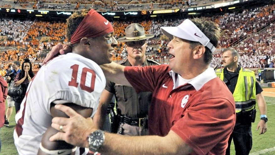 Sep 12, 2015; Knoxville, TN, USA; Oklahoma Sooners head coach Bob Stoops celebrates with safety Steven Parker (10) after defeating the Tennessee Volunteers in double overtime at Neyland Stadium. Oklahoma won 31-24. Mandatory Credit: Jim Brown-USA TODAY Sports