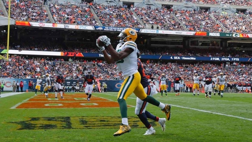 Green Bay Packers wide receiver Randall Cobb makes a touchdown reception under pressure from Chicago Bears cornerback Sherrick McManis during the second half of an NFL football game, Sunday, Sept. 13, 2015, in Chicago.