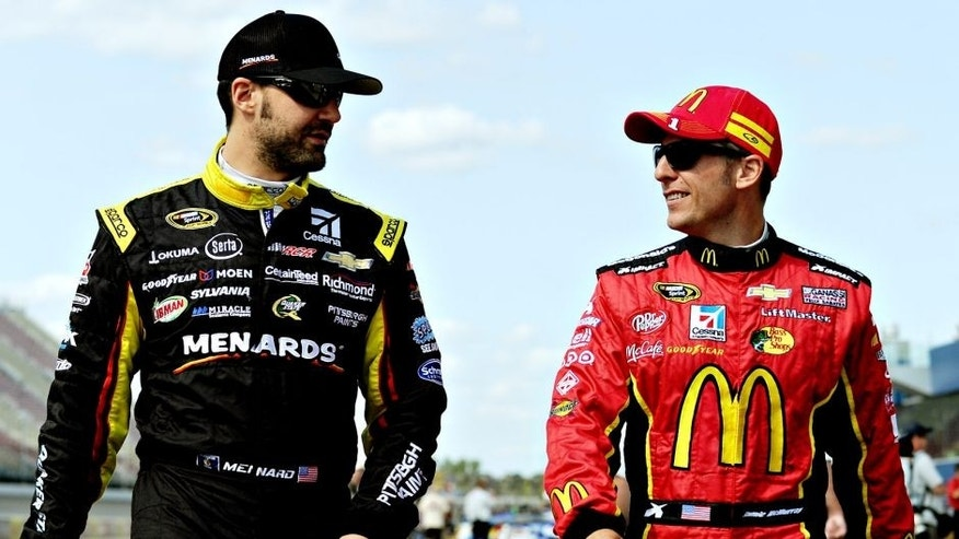 BROOKLYN, MI - AUGUST 15: Paul Menard (L), driver of the #27 CertainTeed/Menard's Chevrolet, talks to Jamie McMurray, driver of the #1 McDonald's Chevrolet, on the grid during qualifying for the NASCAR Sprint Cup Series Pure Michigan 400 at Michigan International Speedway on August 15, 2014 in Brooklyn, Michigan. (Photo by Will Schneekloth/NASCAR via Getty Images)