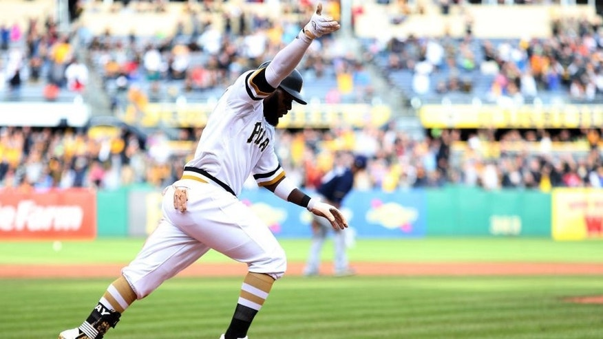 Sep 13, 2015; Pittsburgh, PA, USA; Pittsburgh Pirates left fielder Josh Harrison (5) reacts running to first base after hitting a game winning RBI single against the Milwaukee Brewers during the eleventh inning at PNC Park. The Pirates won 7-6 in eleven innings. Mandatory Credit: Charles LeClaire-USA TODAY Sports