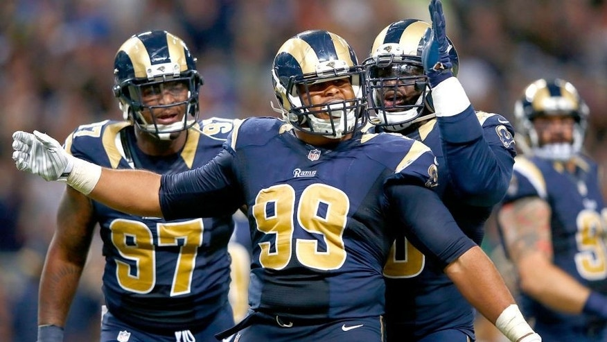 ST. LOUIS, MO - SEPTEMBER 13: Aaron Donald #99 of the St. Louis Rams celebrates a third quarter sack against the Seattle Seahawks at the Edward Jones Dome on September 13, 2015 in St. Louis, Missouri. (Photo by Jamie Squire/Getty Images)