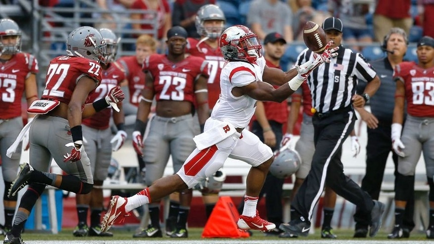 SEATTLE, WA - AUGUST 28: Wide receiver Leonte Carroo #4 of the Rutgers Scarlet Knights makes a touchdown catch on the first play of the game against the Washington State Cougars at CenturyLink Field on August 28, 2014 in Seattle, Washington. (Photo by Otto Greule Jr/Getty Images)