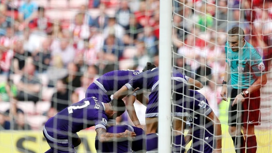 Tottenham Hotspur's Ryan Mason, center bottom, celebrates his goal with his teammates during their English Premier League soccer match between Sunderland and Tottenham Hotspur at the Stadium of Light, Sunderland, England, Sunday, Sept. 13, 2015. (AP Photo/Scott Heppell)