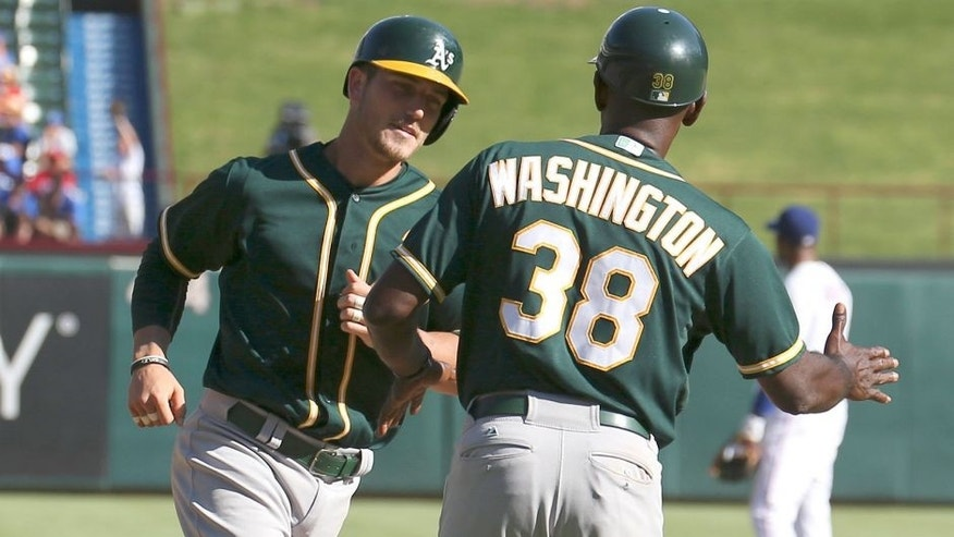 The Oakland Athletics' Carson Blair (39) is congratulated by third base coach Ron Washington (38) following his first major league hit, a home run, against the Texas Rangers during the seventh inning on Sunday, Sept. 13, 2015, at Globe Life Park in Arlington, Texas. The Rangers won, 12-4. (Jim Cowsert/Fort Worth Star-Telegram/TNS via Getty Images)