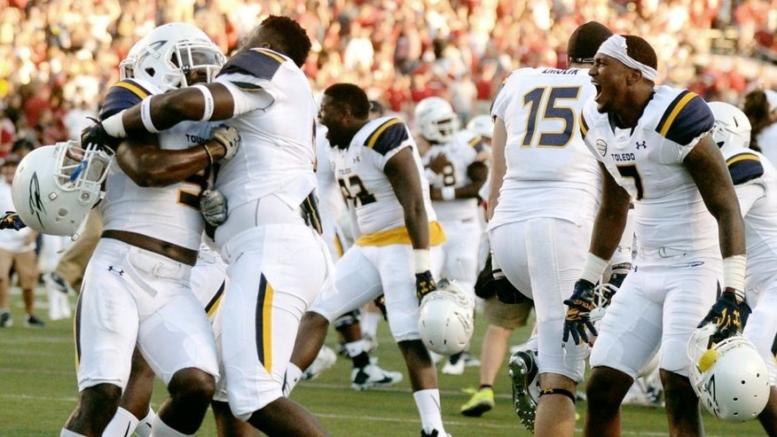 Sep 12, 2015; Little Rock, AR, USA; The Toledo Rockets celebrate against the Arkansas Razorbacks at War Memorial Stadium. Mandatory Credit: Mark D. Smith-USA TODAY Sports