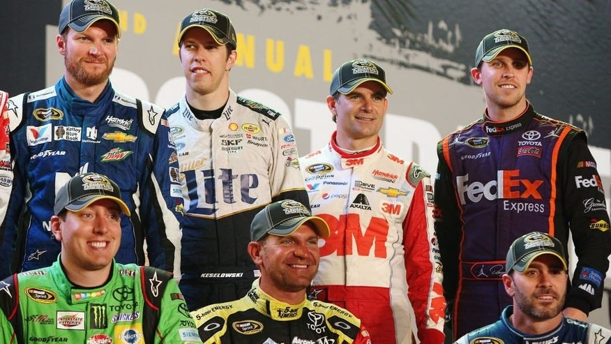 RICHMOND, VA - SEPTEMBER 12: (L-R back row) Dale Earnhardt Jr., driver of the #88 Nationwide Chevrolet, Brad Keselowski, driver of the #2 Miller Lite Ford, Jeff Gordon, driver of the #24 3M Chevrolet, Denny Hamlin, driver of the #11 FedEx Express Toyota, (L-R front row) Kyle Busch, driver of the #18 M&M's Crispy/American Heritage Chocolate Toyota, Clint Bowyer, driver of the #15 5-hour Energy Toyota, and Jimmie Johnson, driver of the #48 Lowe's Chevrolet, pose for a photo during the Post Race Party after making the Chase for the Sprint Cup after the NASCAR Sprint Cup Series Federated Auto Parts 400 at Richmond International Raceway on September 12, 2015 in Richmond, Virginia. (Photo by Chris Graythen/Getty Images)