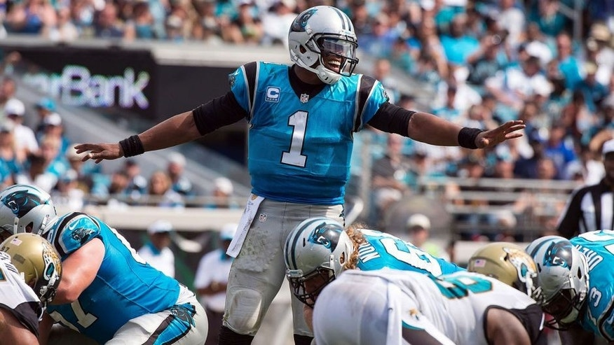 Sep 13, 2015; Jacksonville, FL, USA; Carolina Panthers quarterback Cam Newton (1) sets the play against the Jacksonville Jaguars during the second half at EverBank Field. The Panthers defeat the Jaguars 20-9. Mandatory Credit: Jerome Miron-USA TODAY Sports
