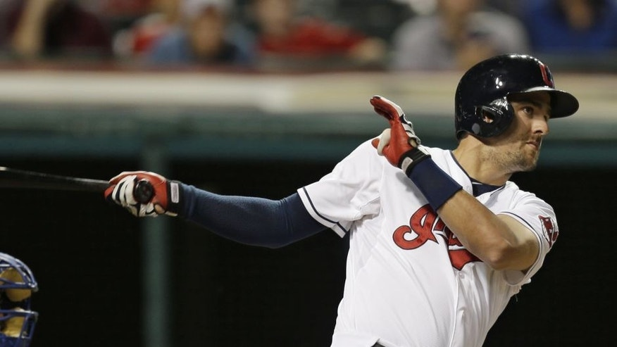 Cleveland Indians' Lonnie Chisenhall hits an RBI-double off Kansas City Royals starting pitcher Edinson Volquez on Monday night