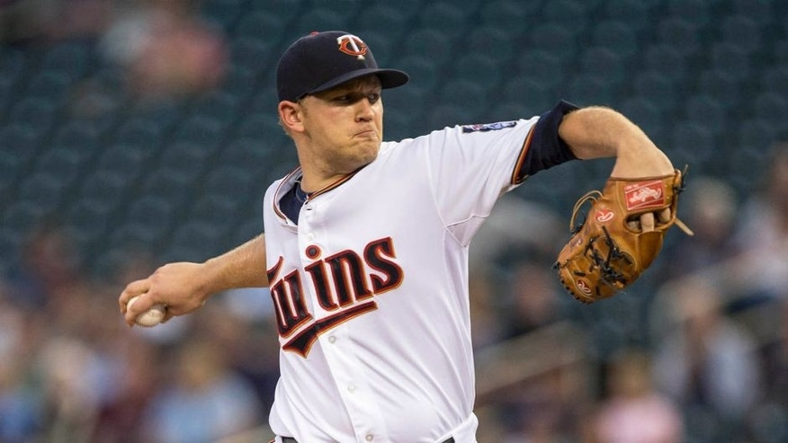 Minnesota Twins starting pitcher Tyler Duffey delivers a pitch against the Detroit Tigers at Target Field in Minneapolis on Monday, Sept. 14, 2015.