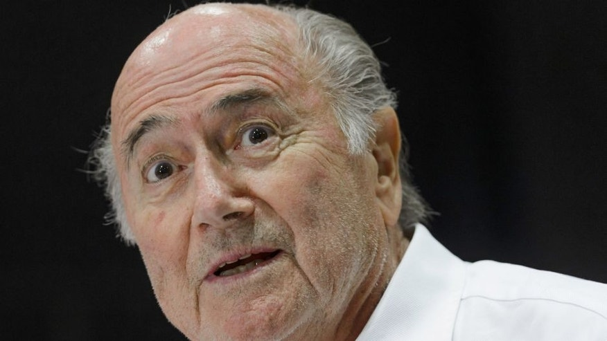 "Outgoing FIFA president Sepp Blatter answers to a press conference during the ""Sepp Blatter Tournament"" on August 22, 2015 in Ulrichen, Blatter's hometown. When Blatter was elected FIFA President in 1998, the town awarded him with the ""honorary burgher"" of Ulrichen title and to commemorate the occasion, a football tournament bearing his name was created. AFP PHOTO / FABRICE COFFRINI (Photo credit should read FABRICE COFFRINI/AFP/Getty Images)"