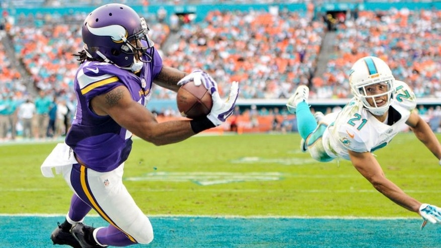 Dec 21, 2014; Miami Gardens, FL, USA; Minnesota Vikings wide receiver Jarius Wright (17) makes the diving touchdown catch as Miami Dolphins cornerback Brent Grimes (21) defends in the second half of the game at Sun Life Stadium. Mandatory Credit: Brad Barr-USA TODAY Sports
