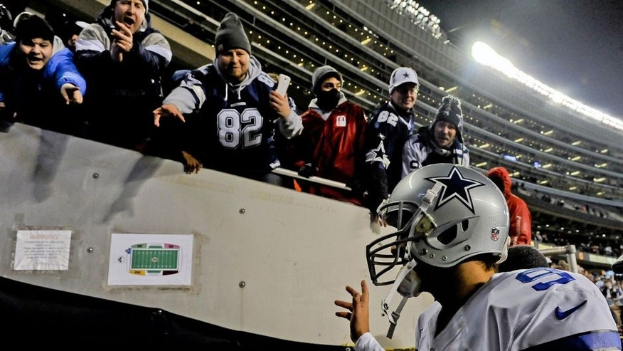 Dec 4, 2014; Chicago, IL, USA; Dallas Cowboys quarterback Tony Romo (9) greets fans after their game at Soldier Field. The Cowboys won 41-28. Mandatory Credit: Matt Marton-USA TODAY Sports